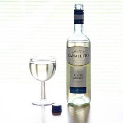 Canaletto pinot grigio wine bottle near glass of wine